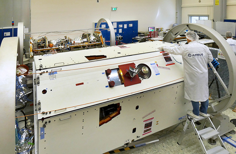 A technician inspects one of the two satellites for NASA's Gravity Recovery and Climate Experiment Follow-On (GRACE-FO) mission at the Airbus Defence and Space manufacturing facility in Friedrichshafen, Germany.