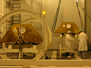 Two GRACE satellites are next to each other in a clean room.
