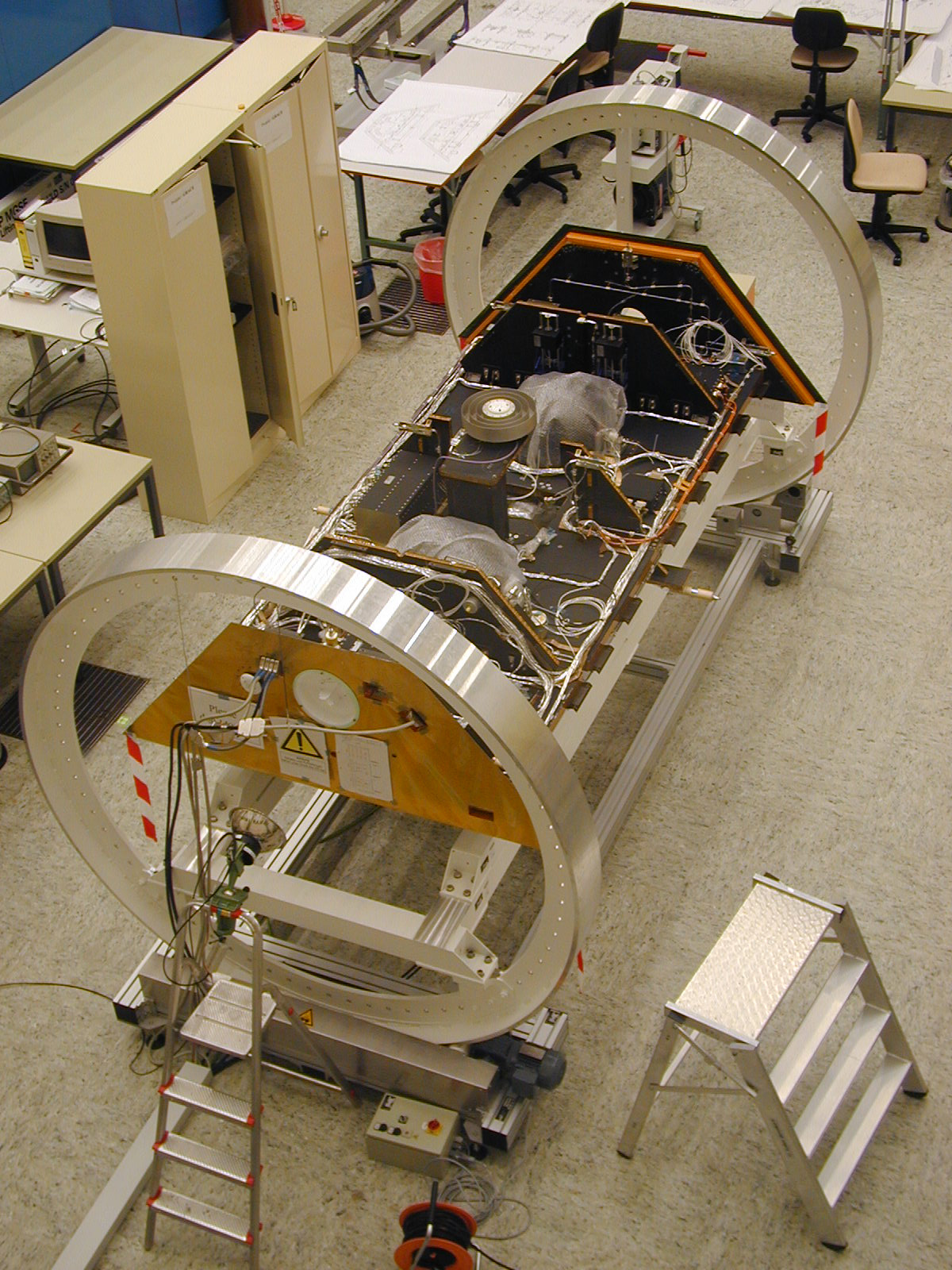 One of the twin GRACE spacecraft is seen during construction in Germany.